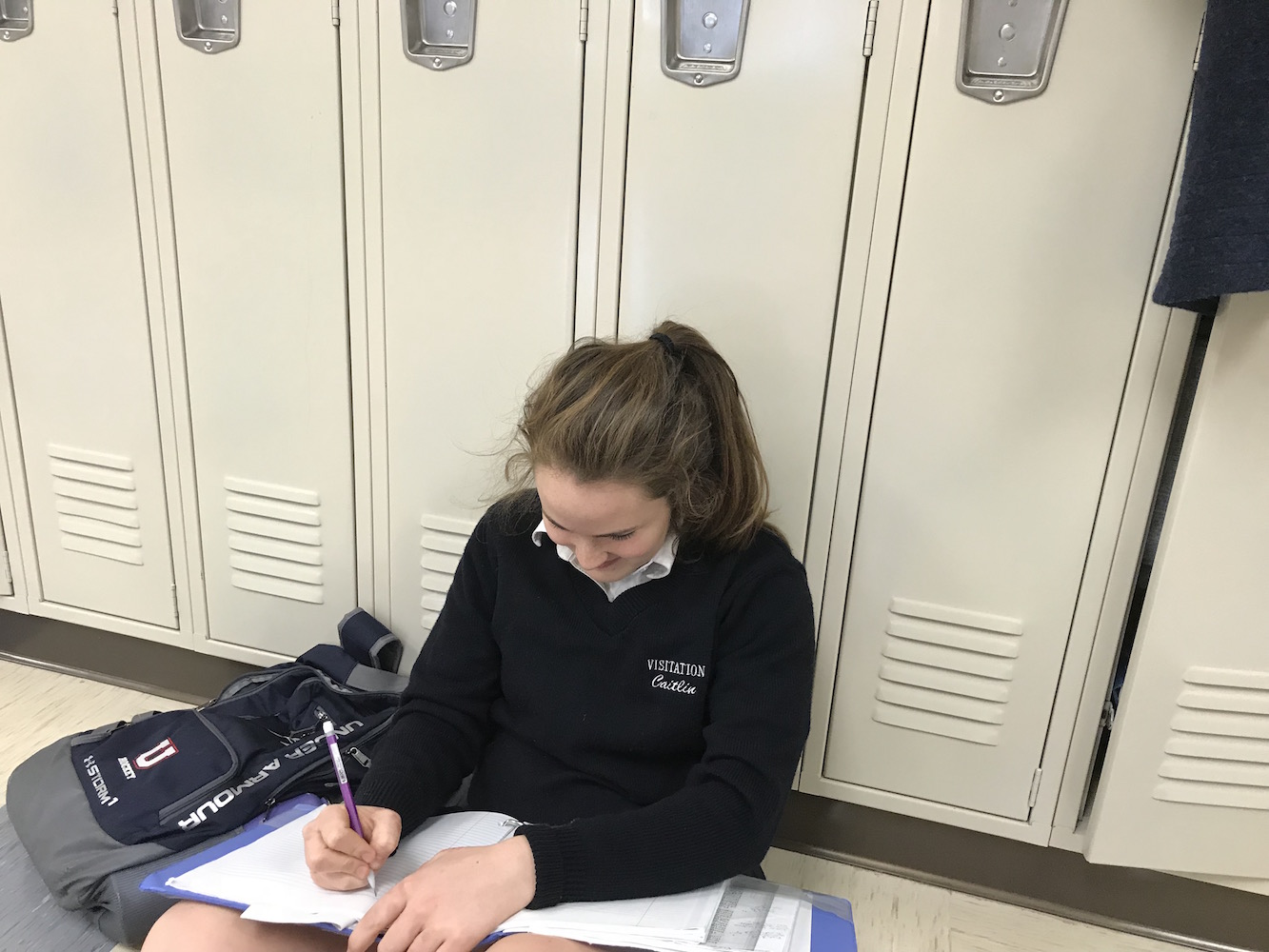 Callie O'Neill studying at her locker.
