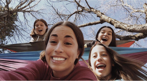 Grace Keeley with friends  Ella Bergeron, Paige Abbott, and Emily Fenlon hammocking on a beautiful day! Photo Courtesy of Grace Keeley